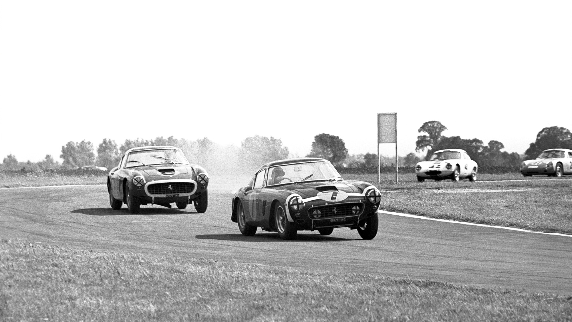 Stirling Moss in a Ferrari 250 GT SWB leads Mike Parkes in the 1961 Tourist Trophy at Goodwood