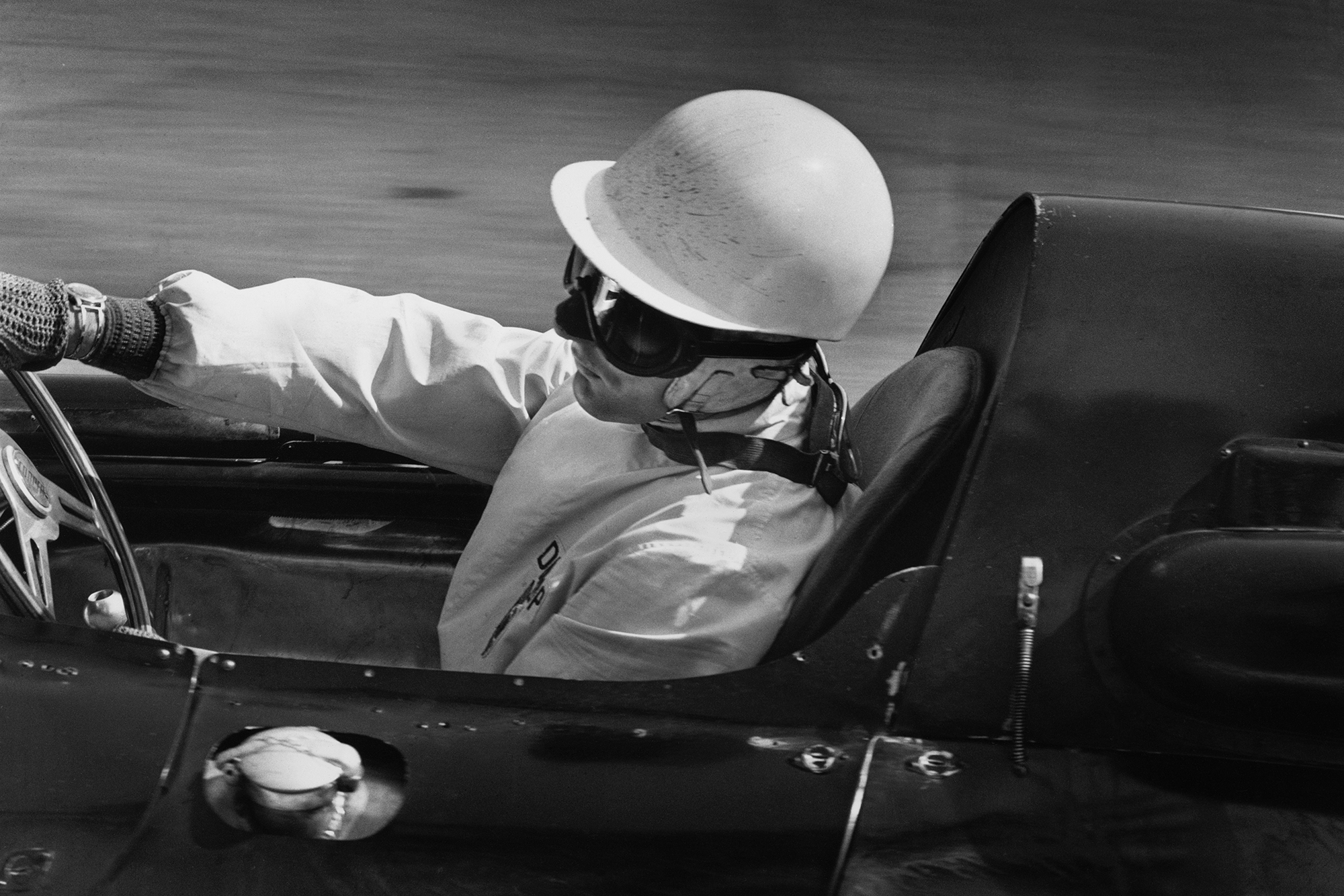 Stirling Moss at the wheel of his Cooper T51-Climax.