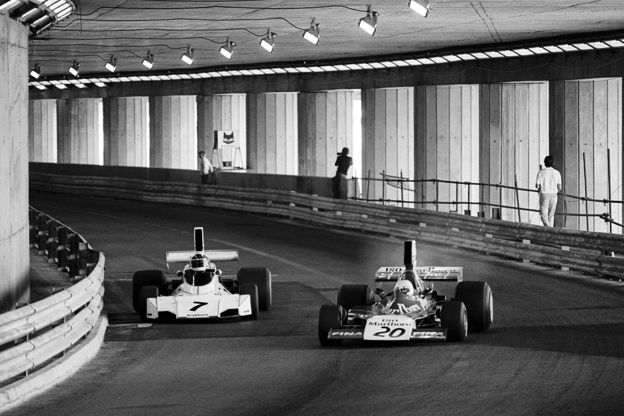 Carlos Reutemann challenges Arturo Merzario in the tunnel during the 1974 Monaco Grand Prix.