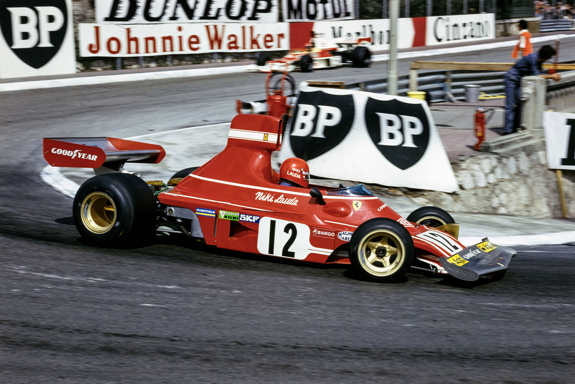 Niki Lauda rounds Loews in his Ferrari a