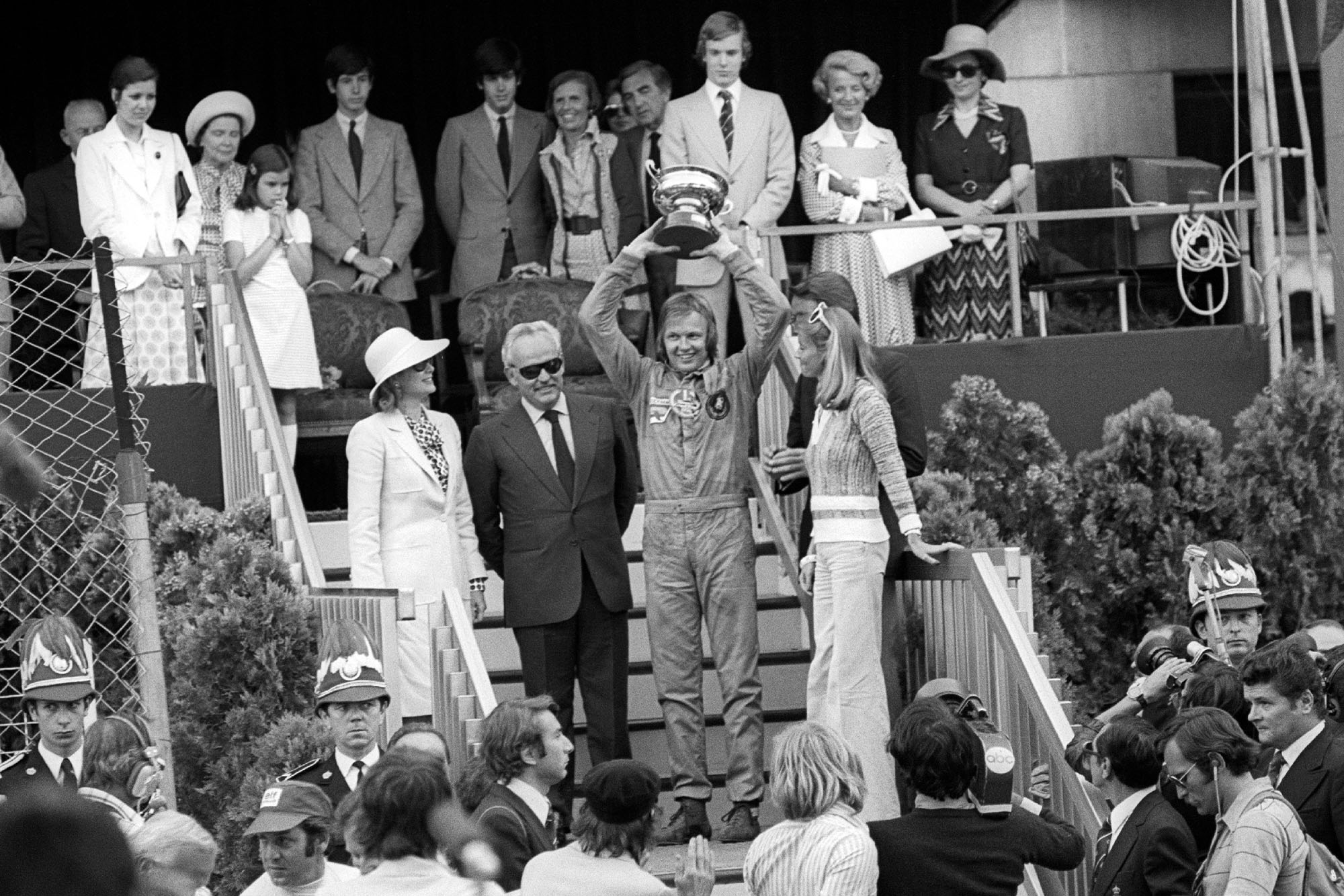 Ronnie Peterson holds the trophy aloft at the 1974 Monaco Grand Prix.
