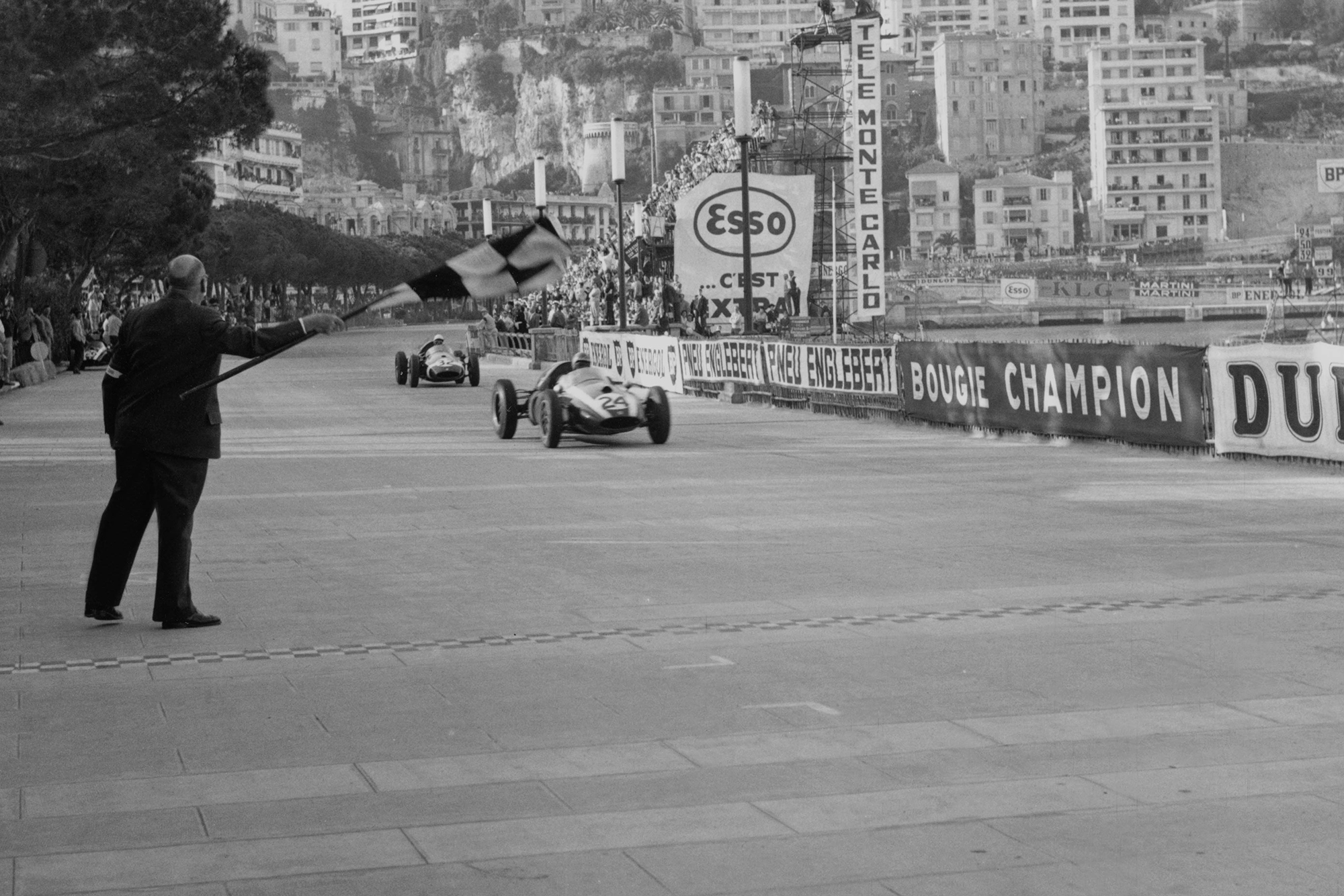 Jack Brabham takes the chequered flag for the win