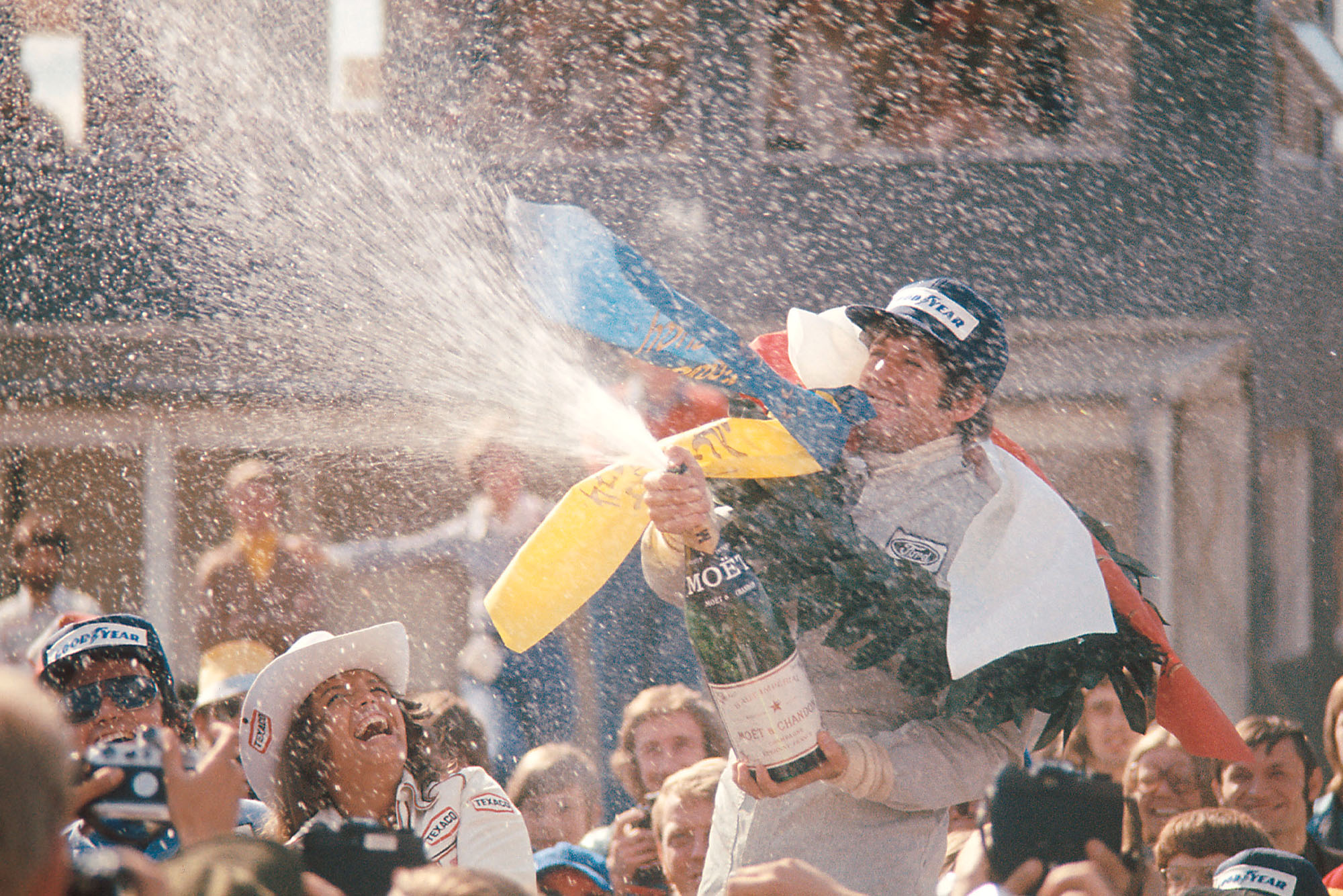 Jody Scheckter sprays the champagne after winning the 1974 Swedish Grand Prix.