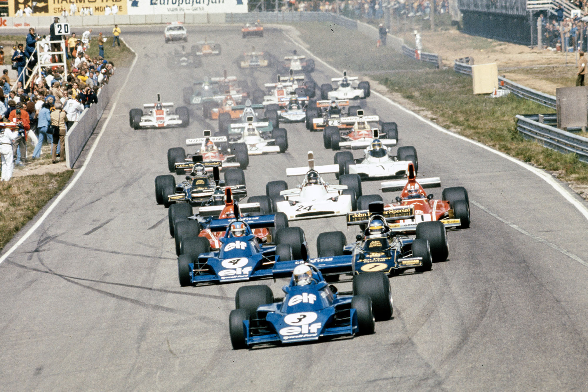 Jody Scheckter (Tyrrell) leads into the first corner of the Spanish Grand Prix.