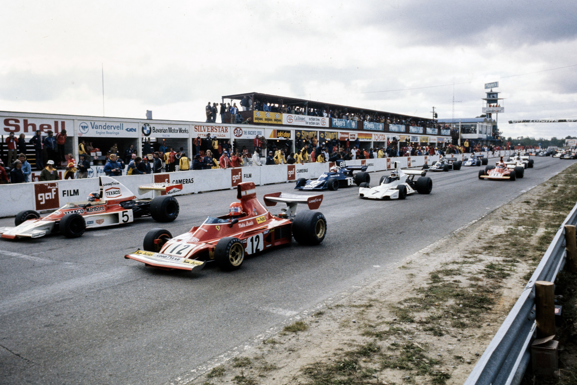 The cars speed off the grid at the 1974 Canadian Grand Prix, Mosport.