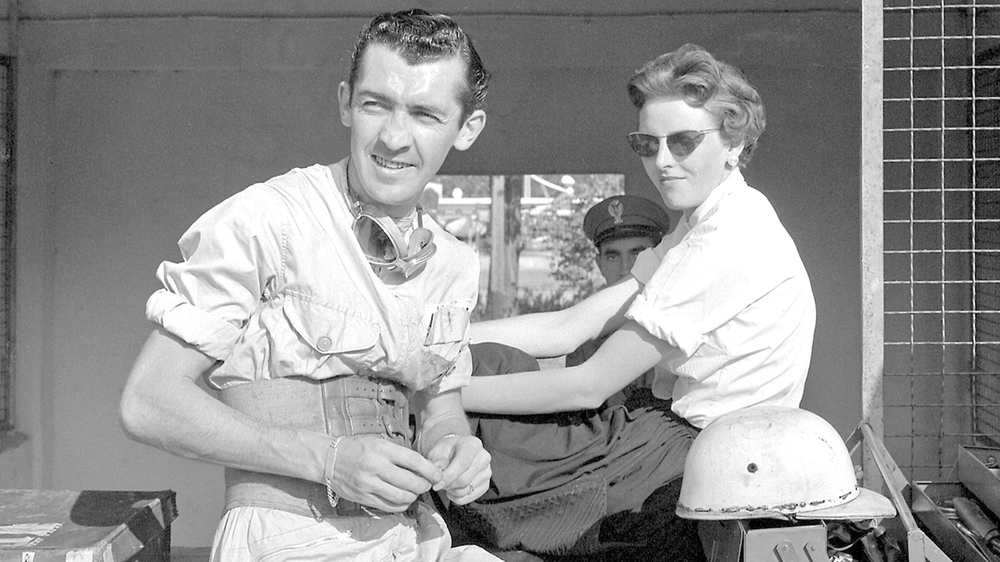 Stuart Lewis-Evans with a girlfriend in the pits at Monza ahead of the 1958 Italian Grand Prix