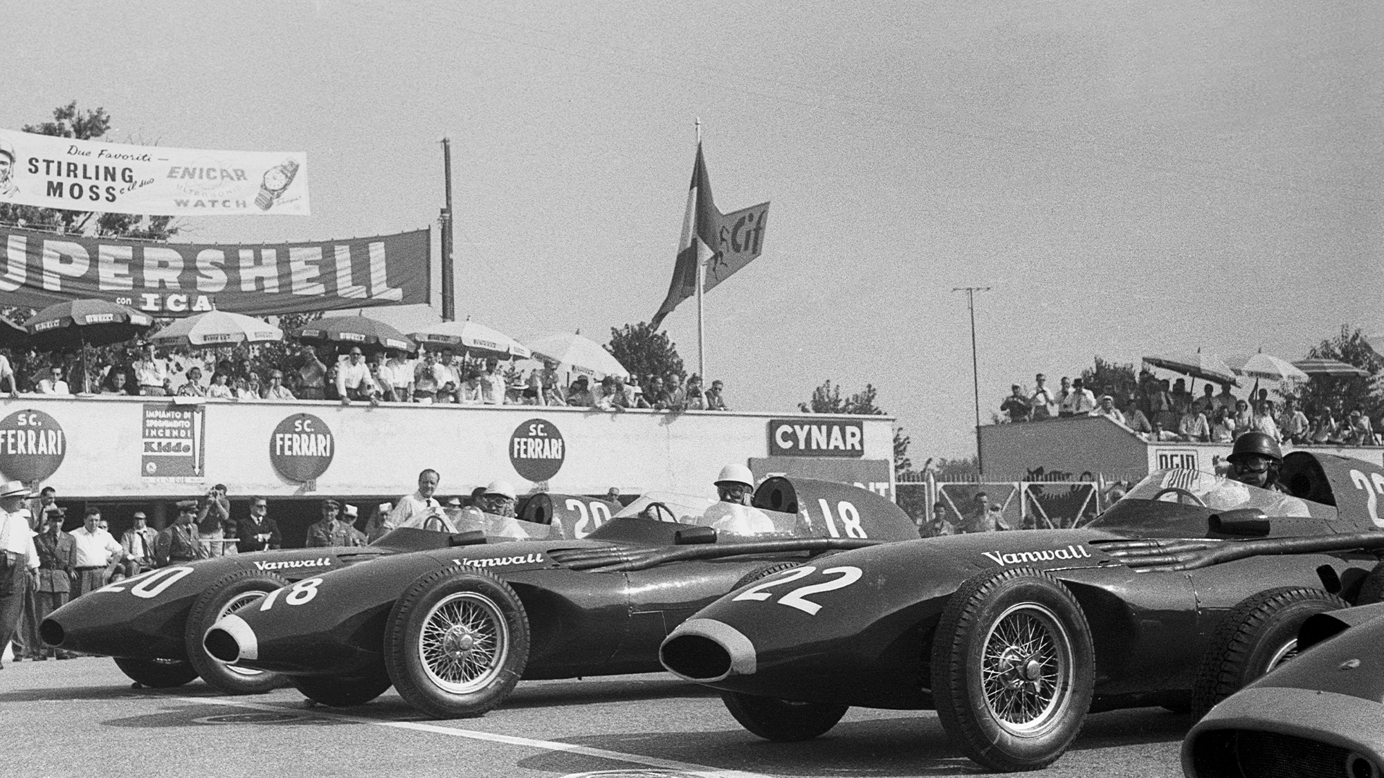 Tony Brooks, Stirling Moss and Stuart Lewis Evans on the front row of the grid at monza ahead of the 1957 Italian Grand Prix