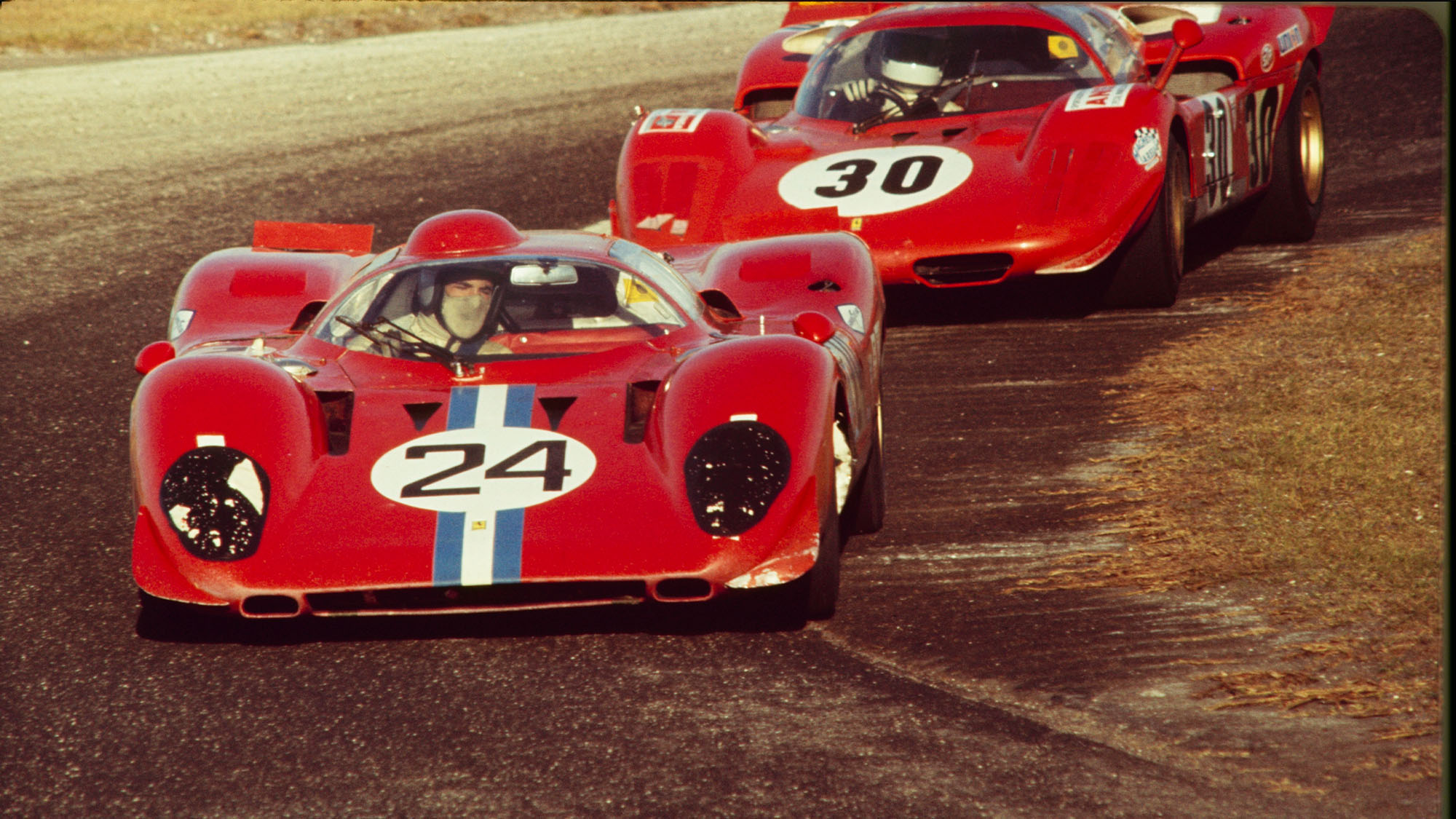 UNITED STATES - FEBRUARY 02: 1970 Daytona 24 Hour Race. Sam Posey and Mike Parkes(24) of N.A.R.T (North American Racing Team) drive their Ferrari 312P in front of Corrado Manfredini and Gianpiero Moretti(30) in the Ferrari 512S. (Photo by /The Enthusiast Network via Getty Images/Getty Images)