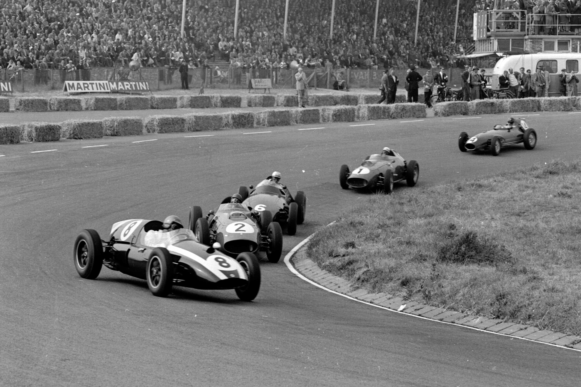 Jack Brabham driving a Cooper T51-Climax leads Tony Brooks' Ferrari Dino 246 and Harry Schell's BRM P25.