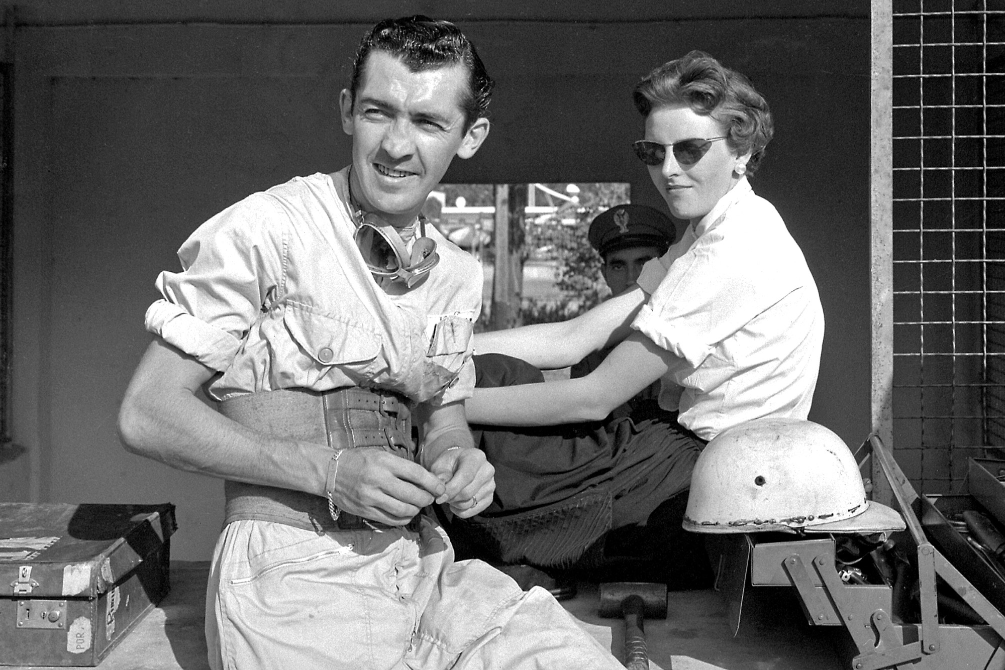 Stuart Lewis-Evans in the pits at Monza with his girlfriend ahead of the 1958 Italian Grand Prix