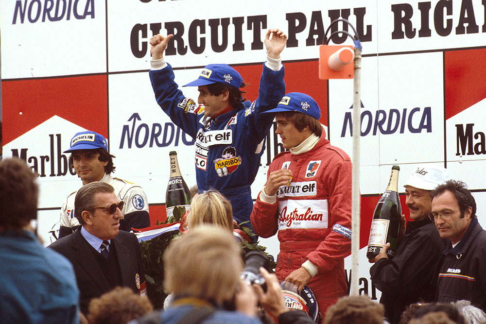 Alain Prost, 1st position, Nelson Piquet 2nd position and Eddie Cheever, 3rd position on the podium.
