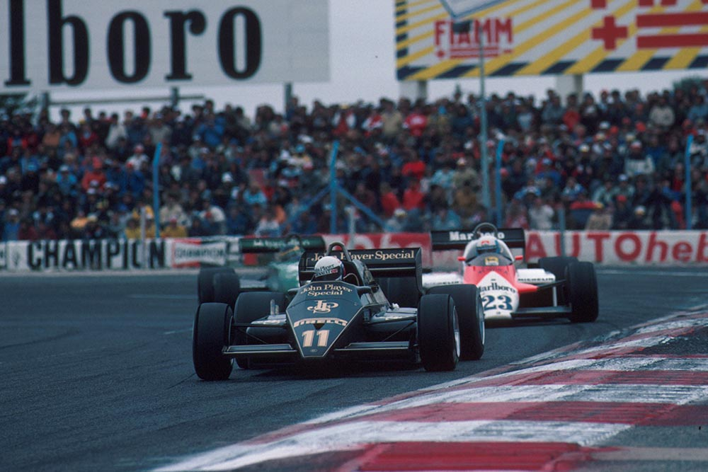 The Lotus of Elio de Angelis leads the Alfa Romeo of Maurro Baldi and the Tyrrell of Michele Alboreto