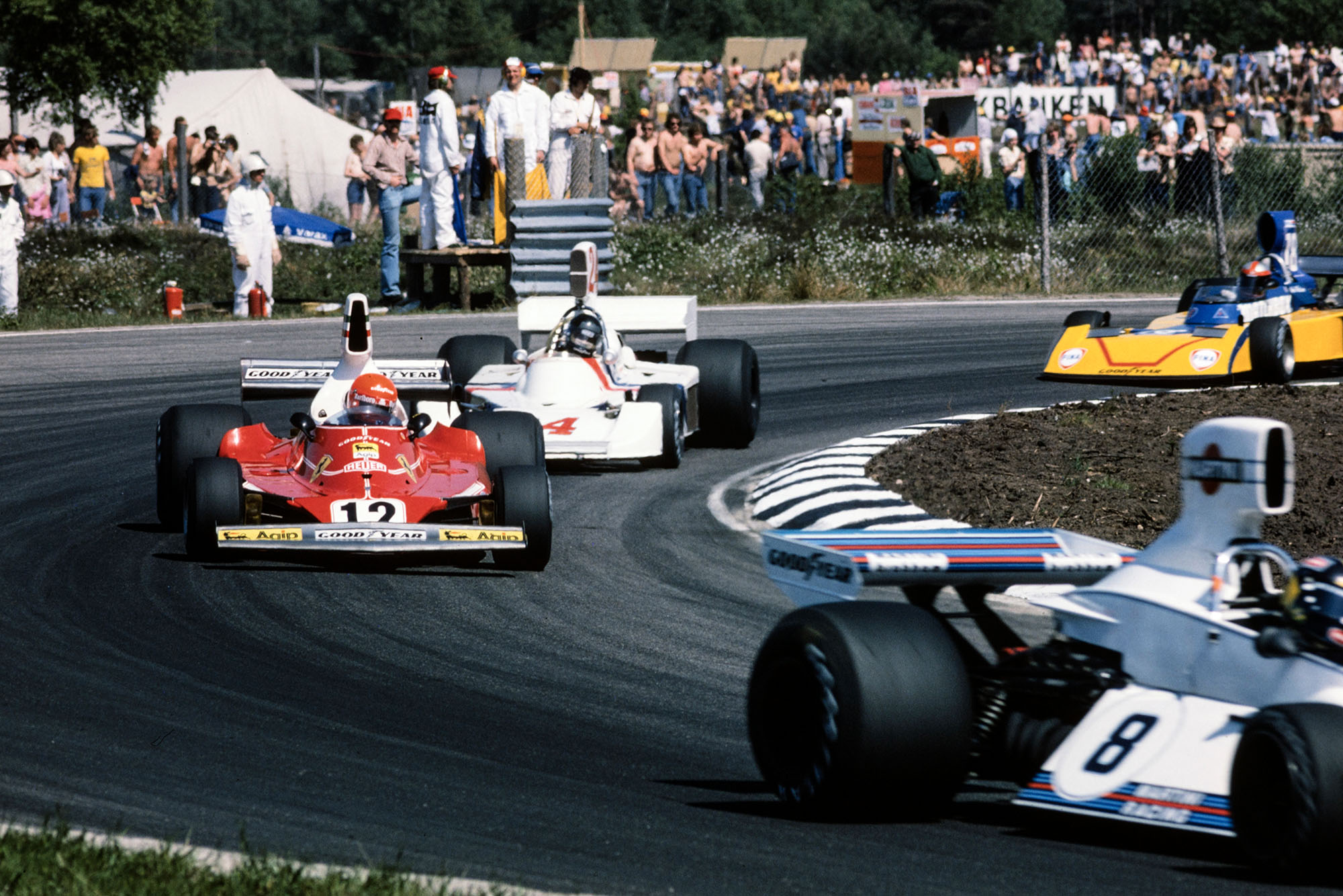 Carlos Pace (Brabham) leads Niki Lauda (Ferrari) and James Hunt (Hesketh).