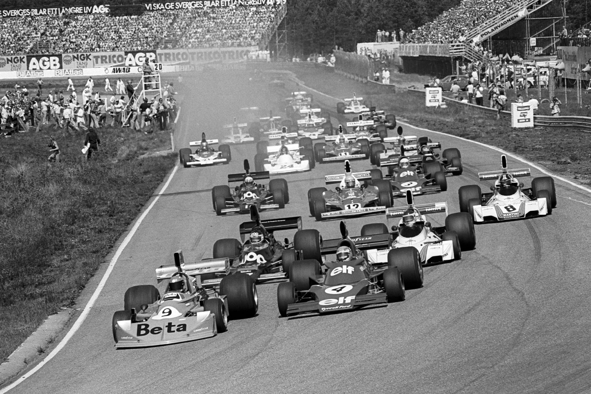 Vittorio Brambilla leads into the first corner of the 1975 Swedish Grand Prix, Anderstorp.