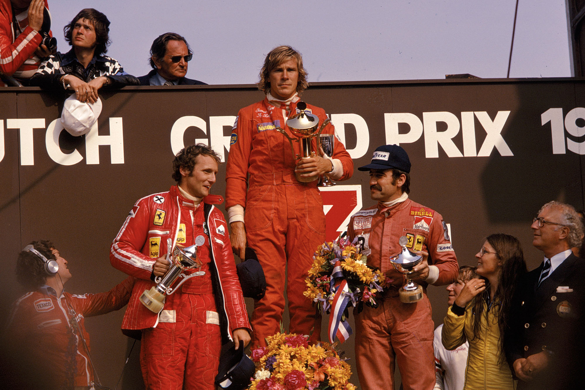 James Hunt (Hesketh) stand son the podium after winning the 1975 Dutch Grand Prix, Zandvoort.
