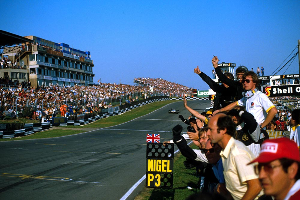 The Lotus team celebrate Nigel Mansell's 3rd place.