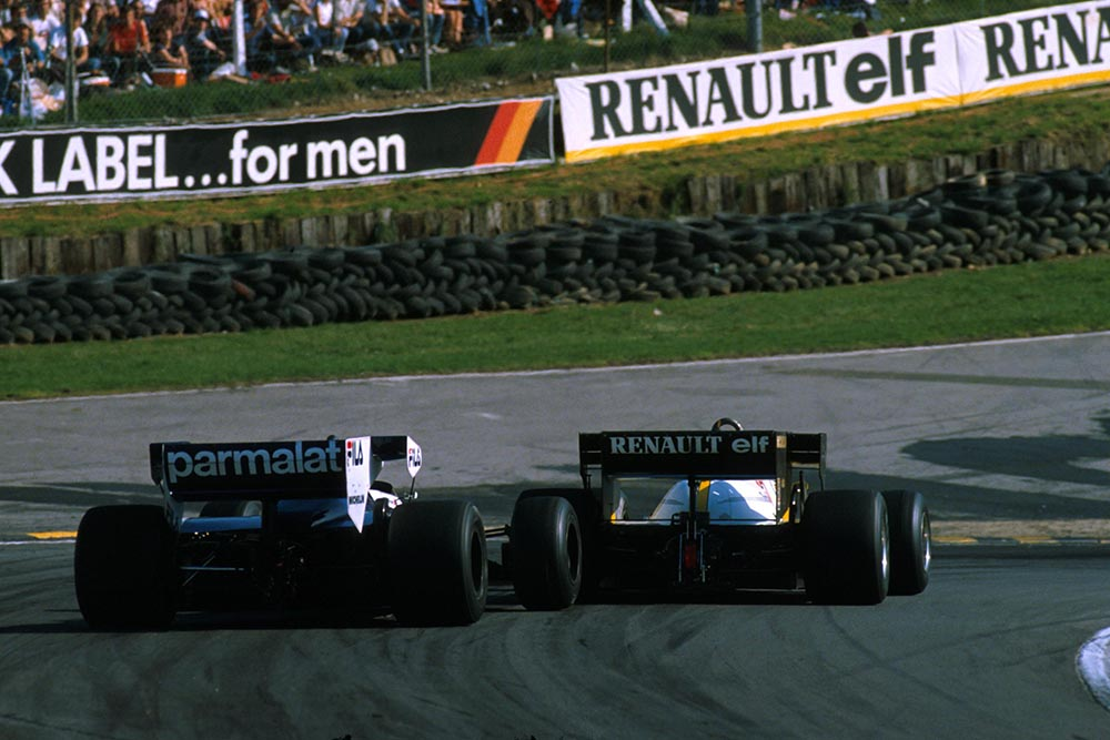 Alain Prost in a Renault RE40 leads eventual winner Nelson Piquet in his Brabham BT52B.