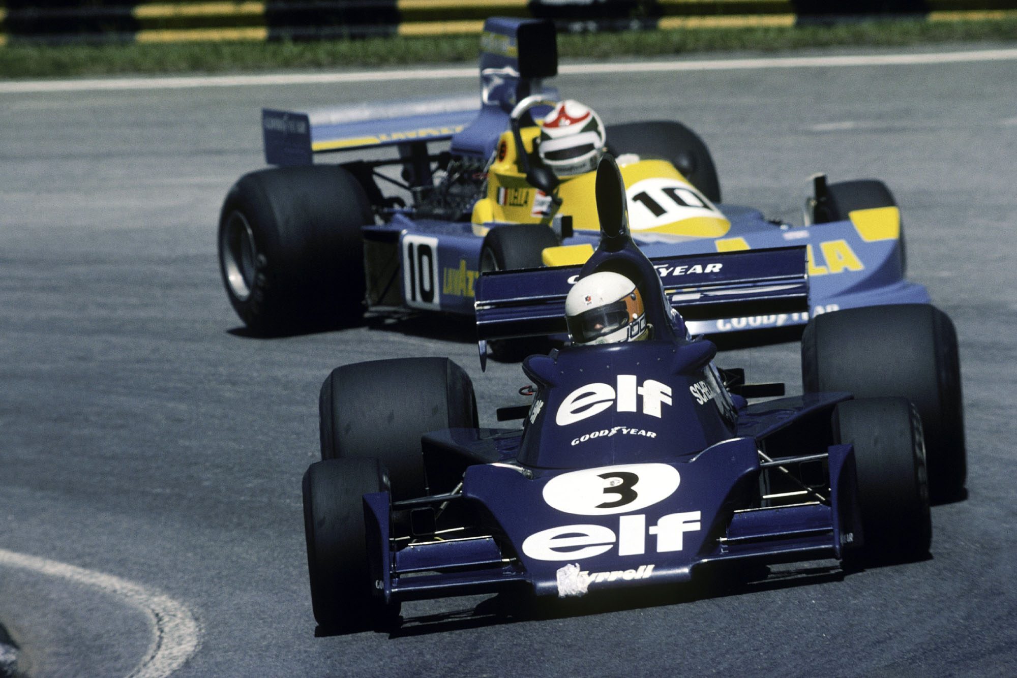 Jody Scheckter keeps his Tyrrell ahead of Lella Lombardi's March during the 1976 Brazilian Grand Prix.