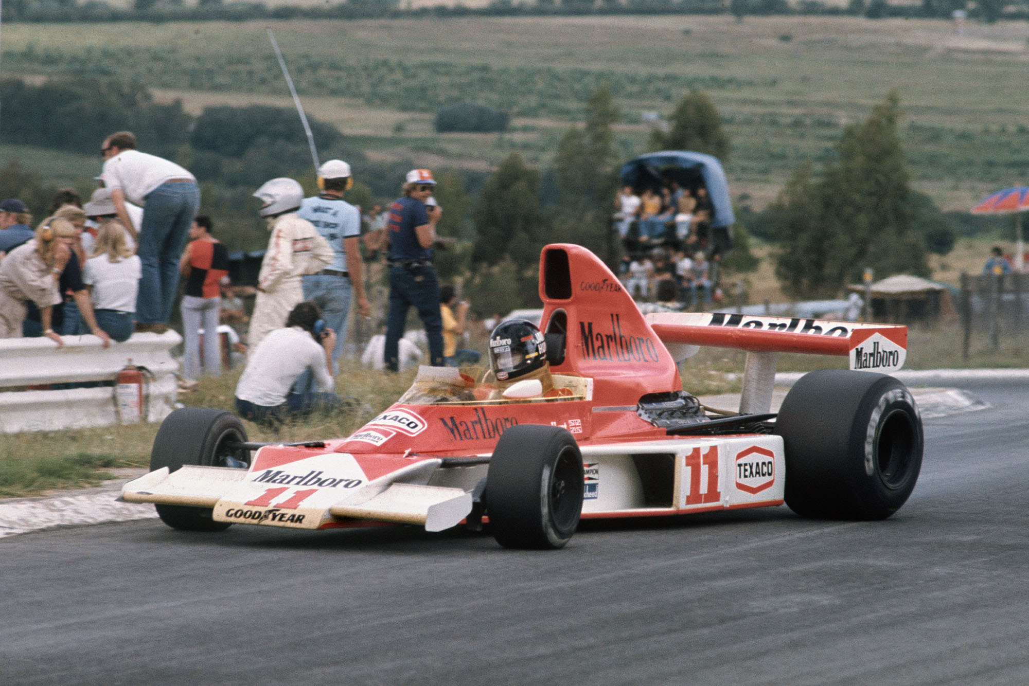 James Hunt (McLaren) dealing with oversteer at the South African Grand Prix, Kyalami.