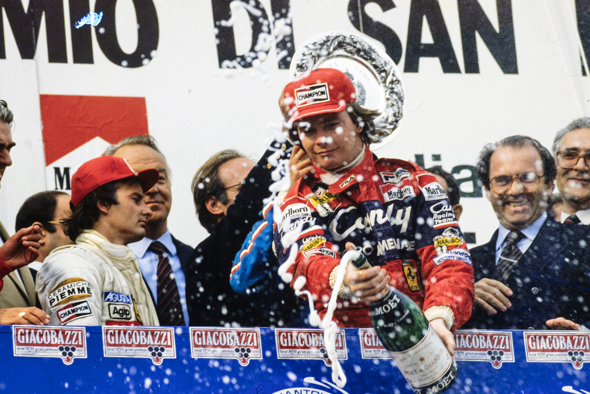Didier Pironi sprays champagne at Imola in 1982 as Gilles Villeneuve looks away