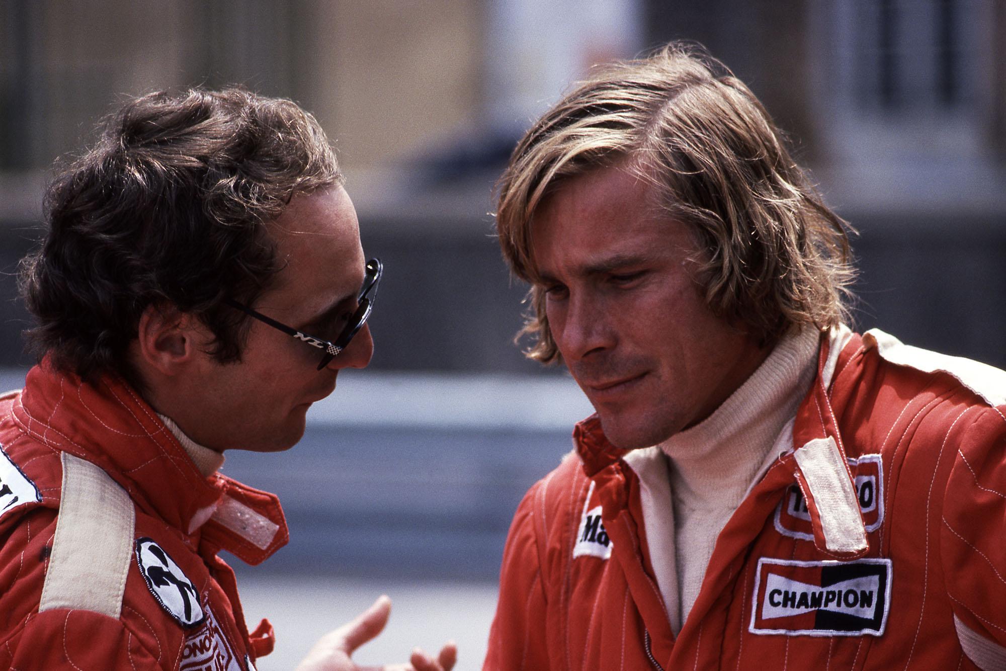 Niki Lauda (Ferrari) talks to James Hunt (McLaren) at the 1976 Monaco Grand Prix.