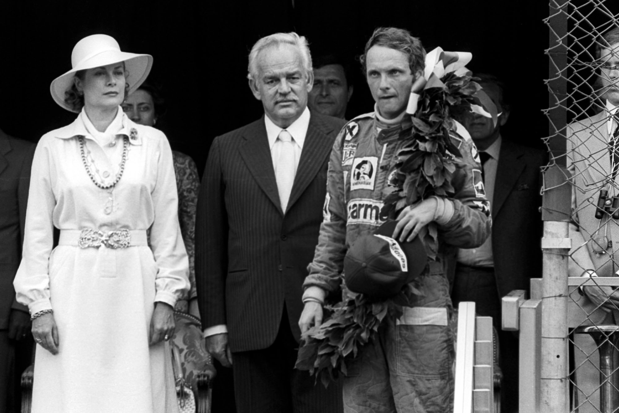 Niki Lauda stands on the podium after emerging victorious at the 1976 Monaco Grand Prix.