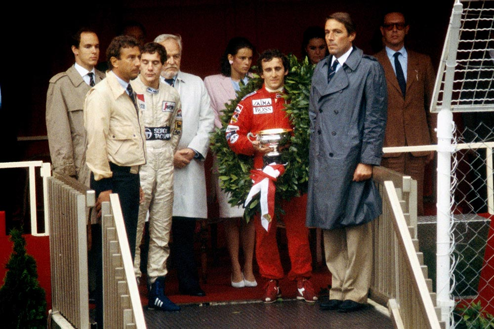 (L to R) Ayrton Senna, 2nd place, winner Alain Prost.