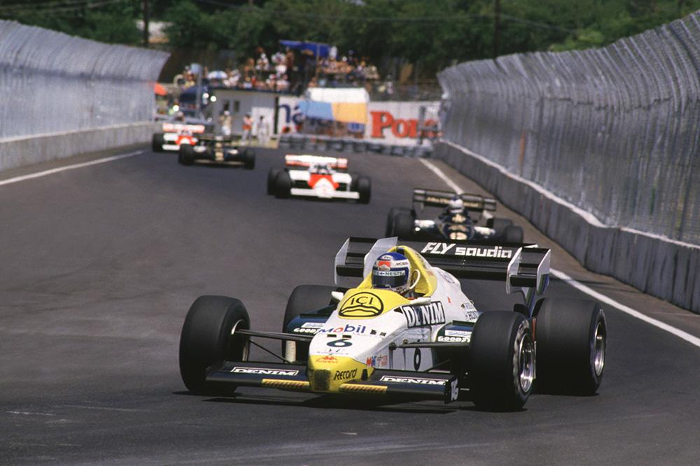 Keke Rosberg leads in his Williams FW09 Honda.