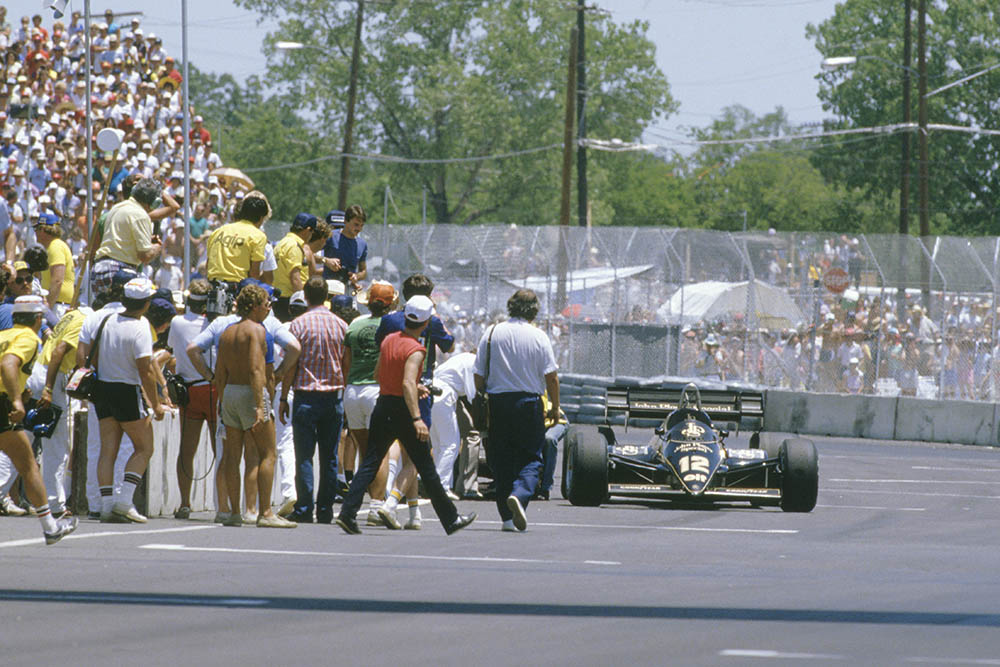 Nigel Mansell (Lotus 95T Renault) near to exhaustion, glanced a wall heavily and damaged the gear selectors on his car. He came to a standstill, then heroicly pushed his car to the line to eventually finish in sixth position.