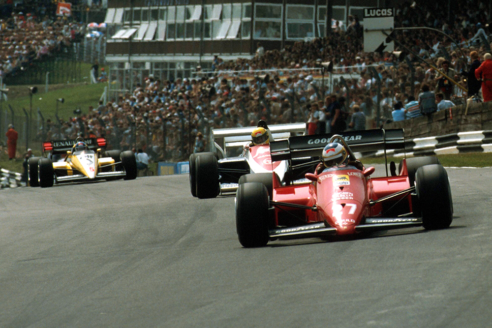 Michele Alboreto (Ferrari 126C4) leads Ayrton Senna (Toleman TG184).
