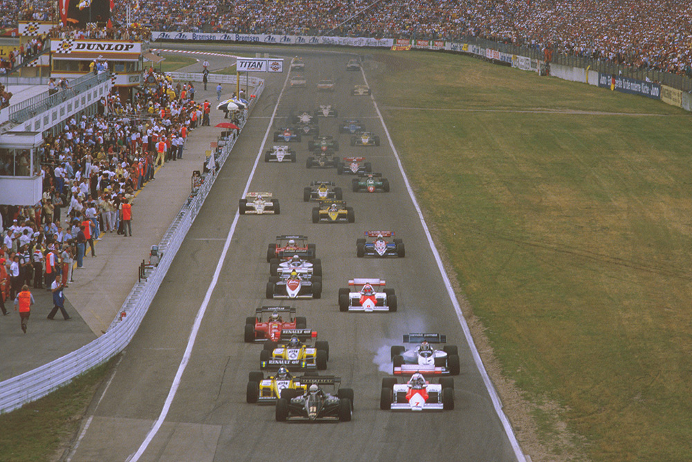 Manfred Winkelhock in his ATS leads a mid field group.