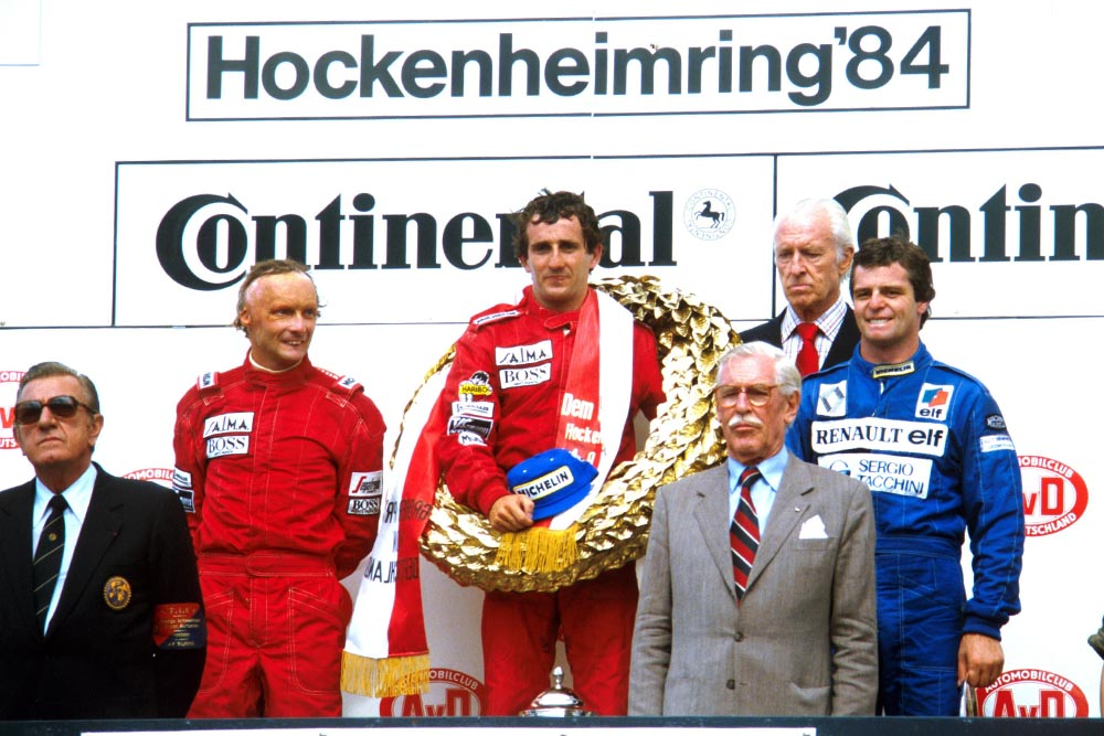 (L-R)Niki Lauda, Winner Alain Prost, and Derek Warwick on the podium.