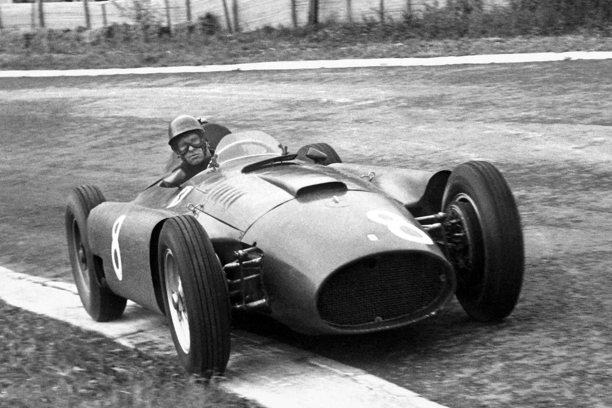 Peter Collins (Lancia-Ferrari D50) on his way to winning the 1956 Belgian Grand Prix, Spa-Francorchamps.