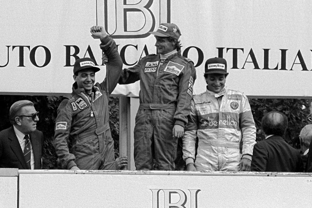 (L to R): Michele Alboreto, second; Niki Lauda, winner and Riccardo Patrese, third on the podium.