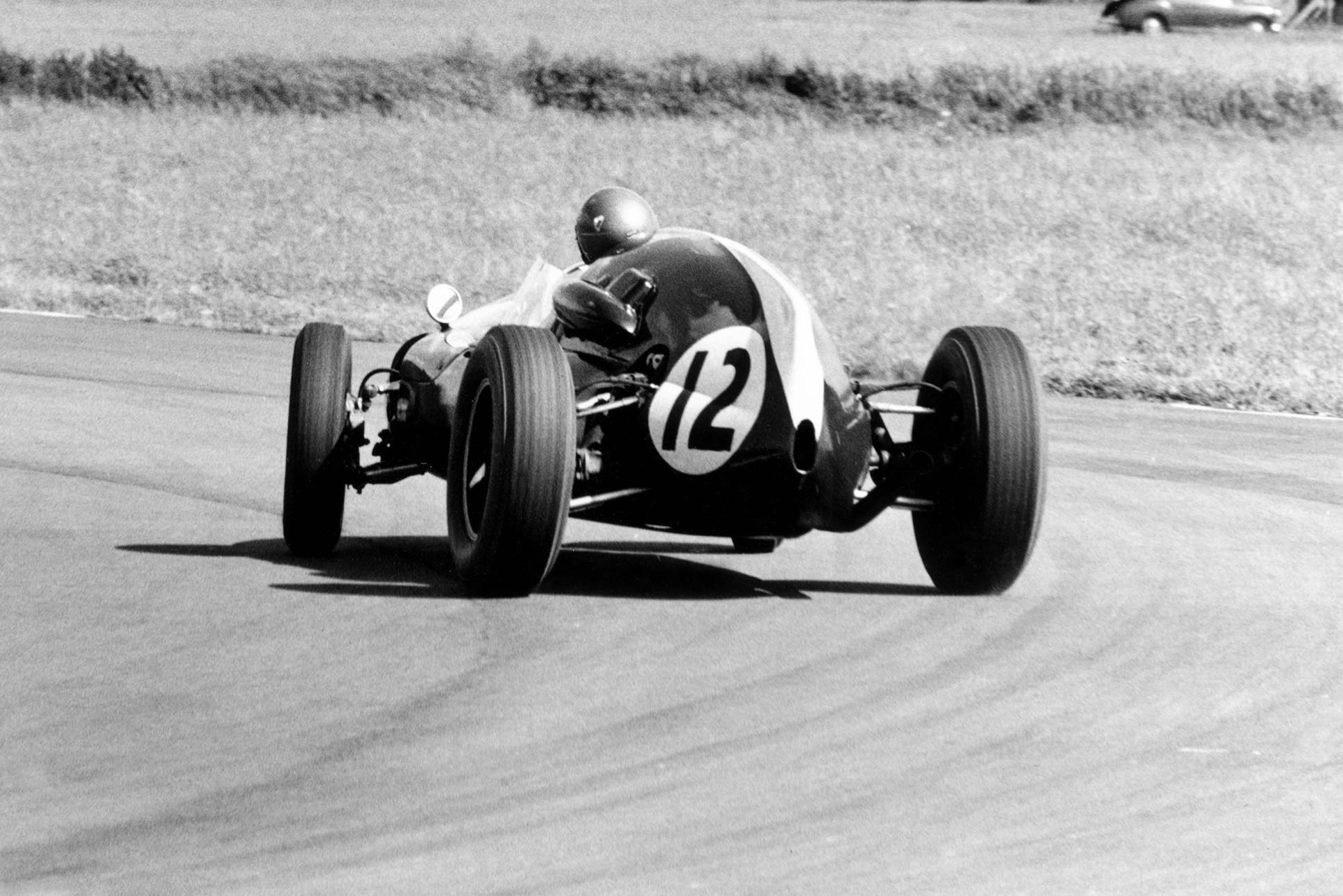 Jack Brabham pushing the Cooper T51-Climax hard.