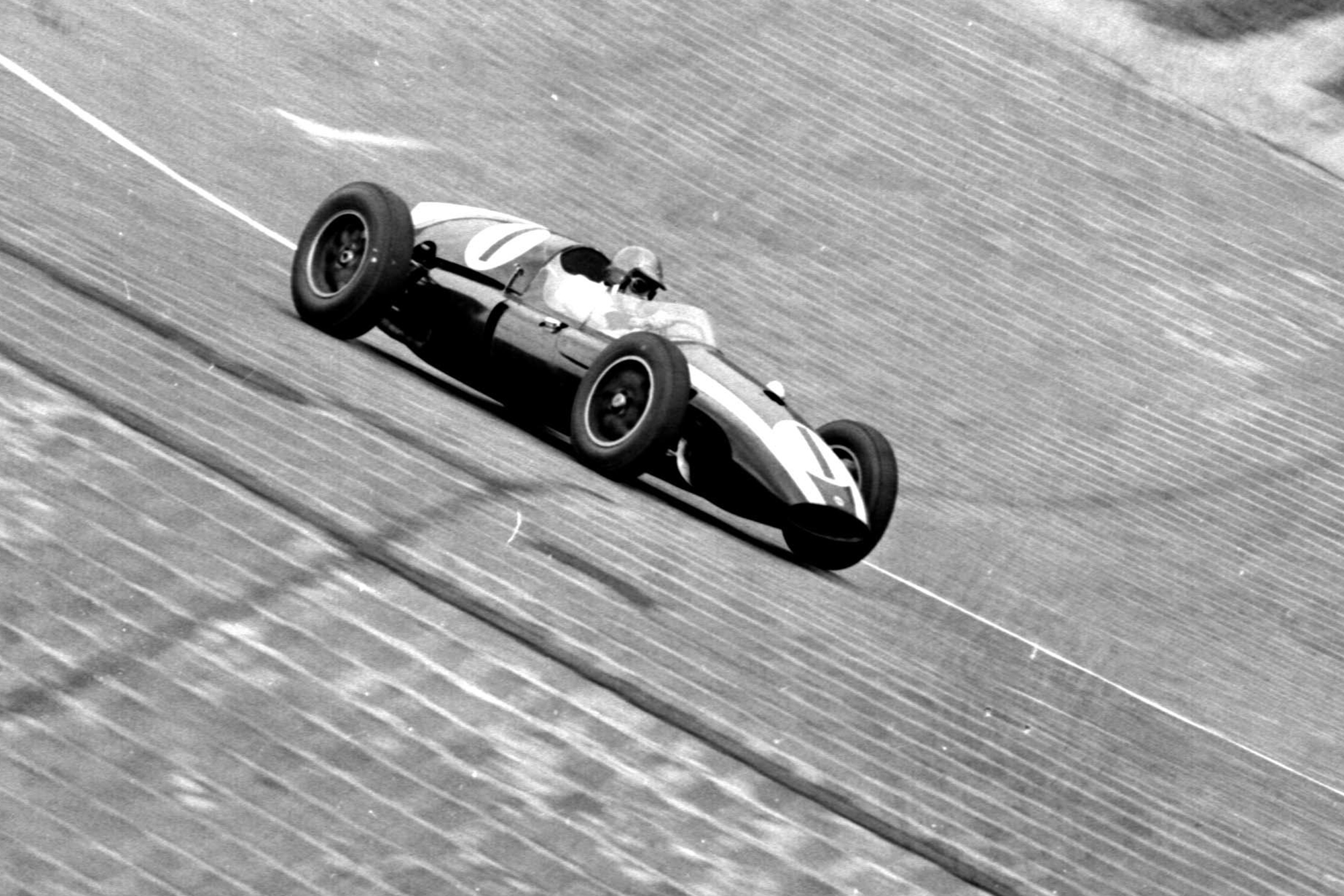 Jack Brabham pushes his Cooper T51 Climax) around the banked North Turn.