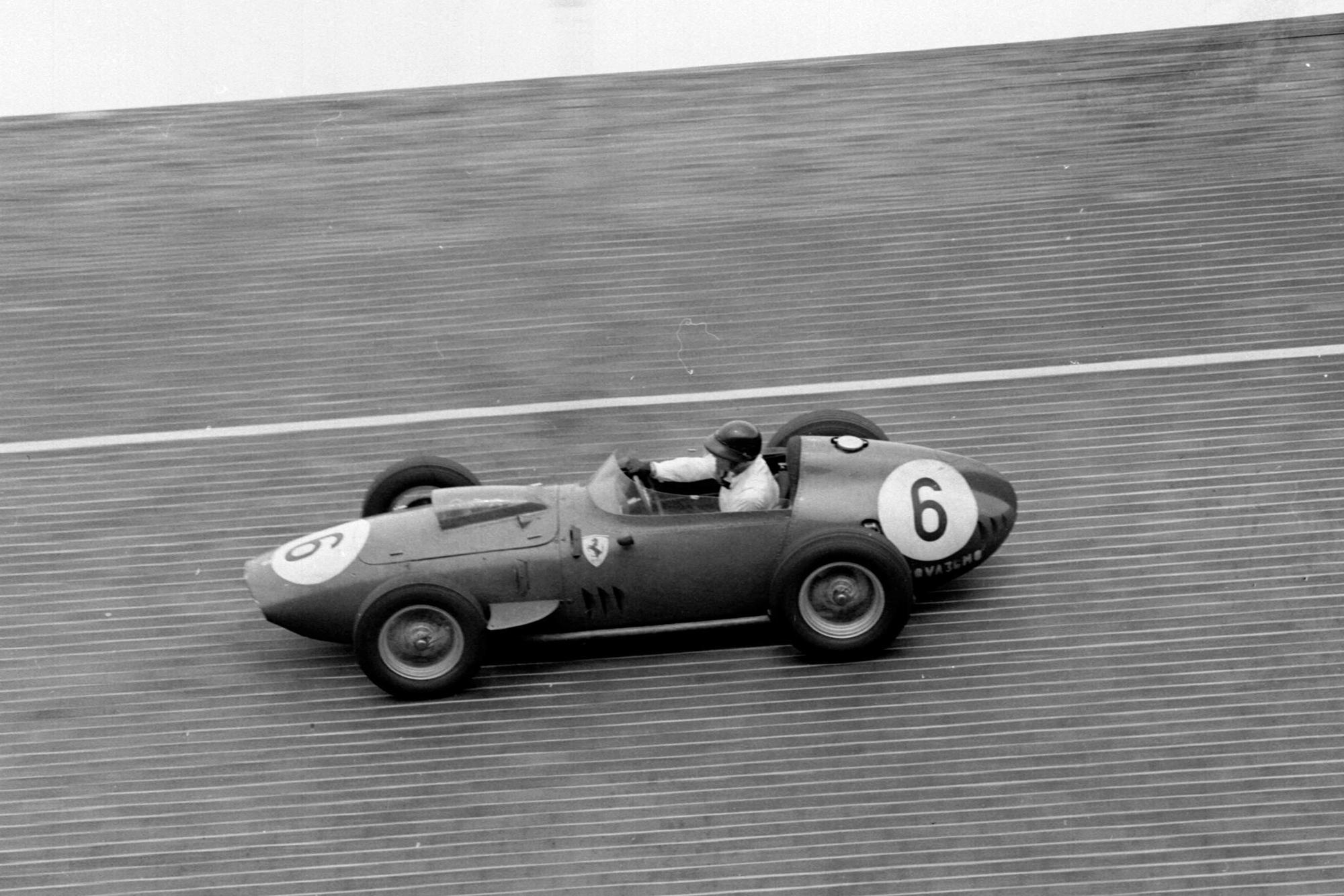Dan Gurney takes his Ferrari Dino 246 around the banked North Turn.