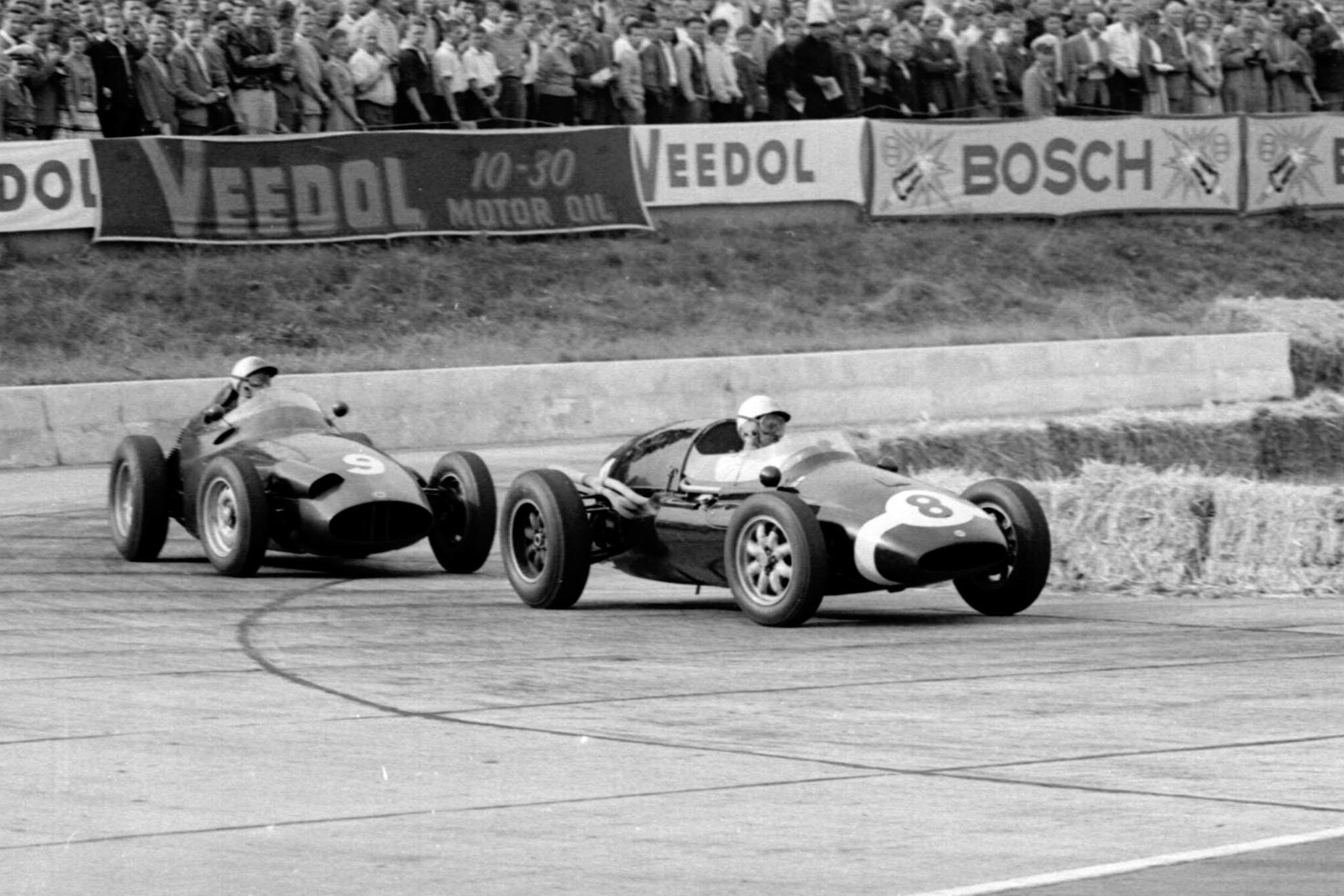 Maurice Trintignant in a Cooper T51 Climax lleads Jo Bonnier in a BRM P25 through the Hairpin.