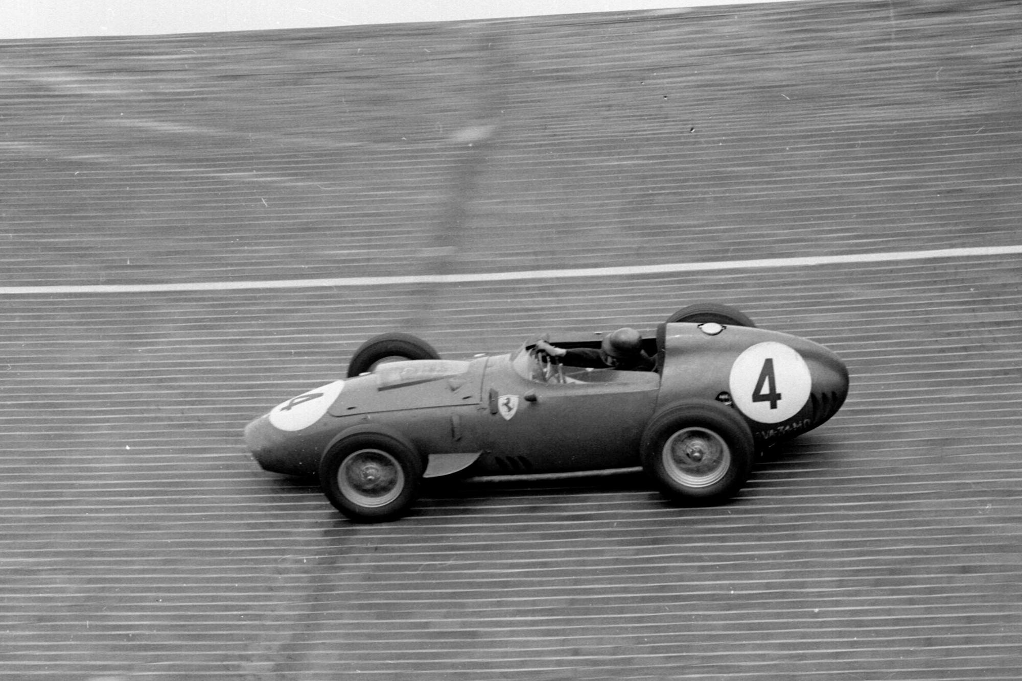 Tony Brooks' Ferrari Dino 246 on the banked North Turn.