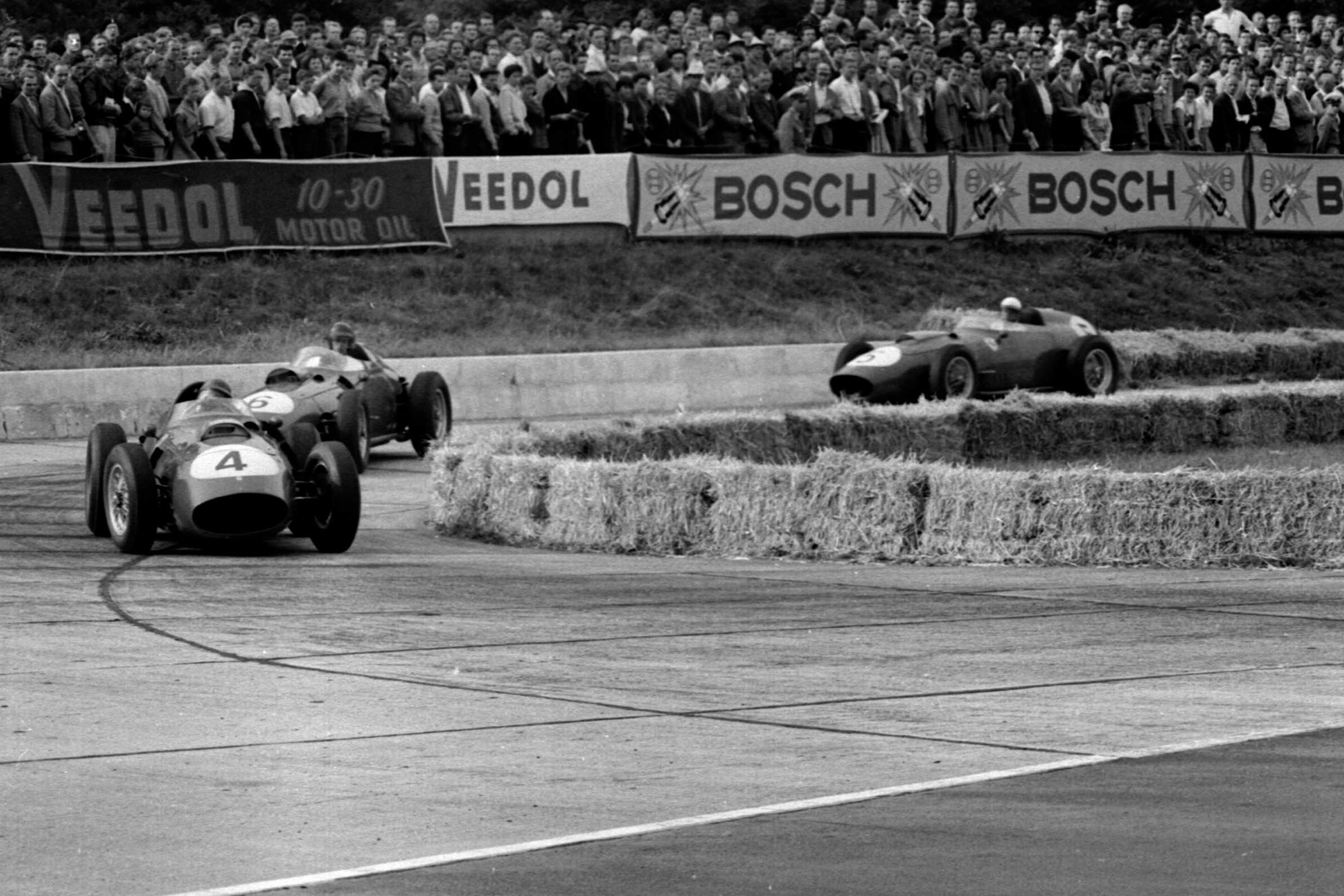Tony Brooks in a Ferrari Dino 246 leads into the Hairpin.