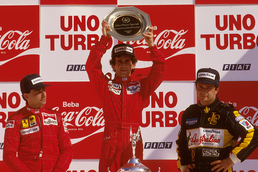 Alain Prost, 1st position, Michele Alboreto, 2nd position and Elio de Angelis, 3rd position on the podium.