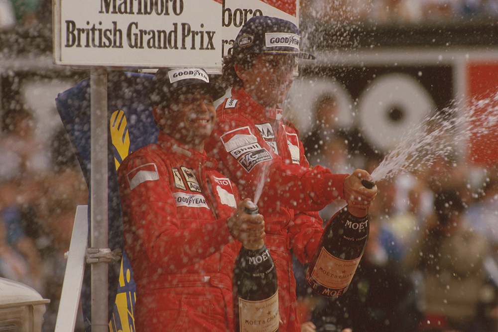 Alain Prost, 1st position, and Michele Alboreto, 2nd position on the podium.
