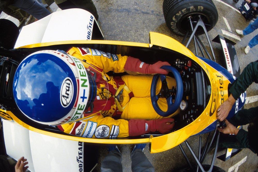 Keke Rosberg sitting in his Williams Honda FW10 .