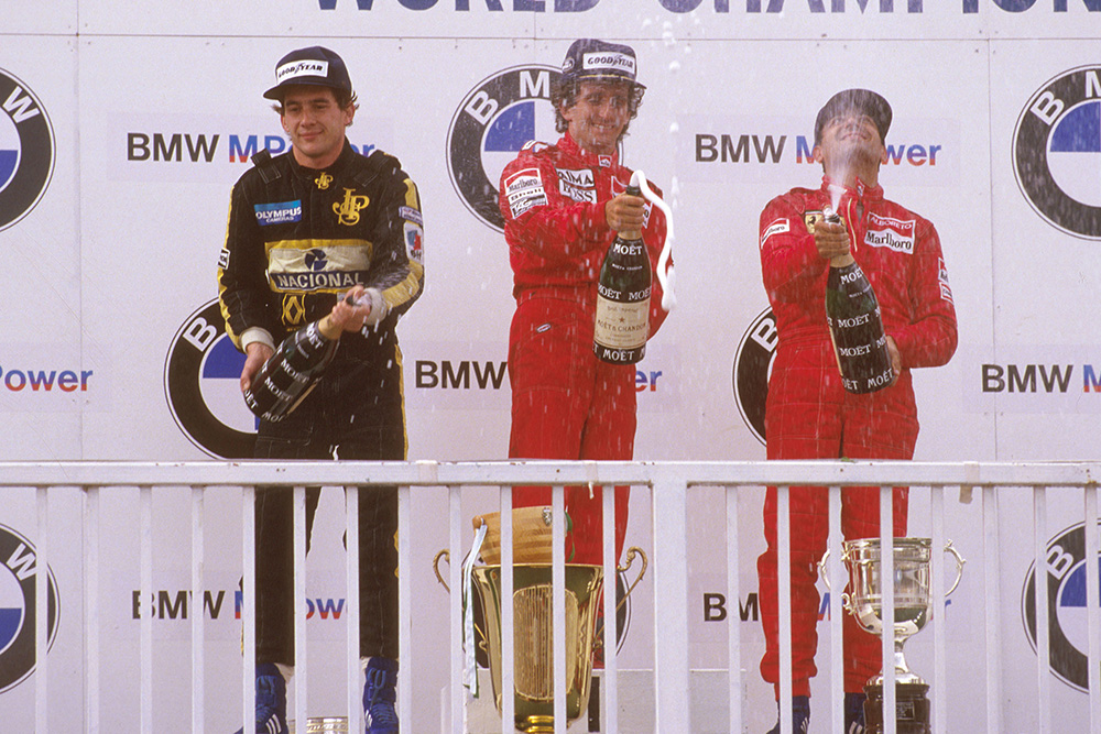 Alain Prost, 1st position, Ayrton Senna, 2nd position and Michele Alboreto, 3rd position on the podium.