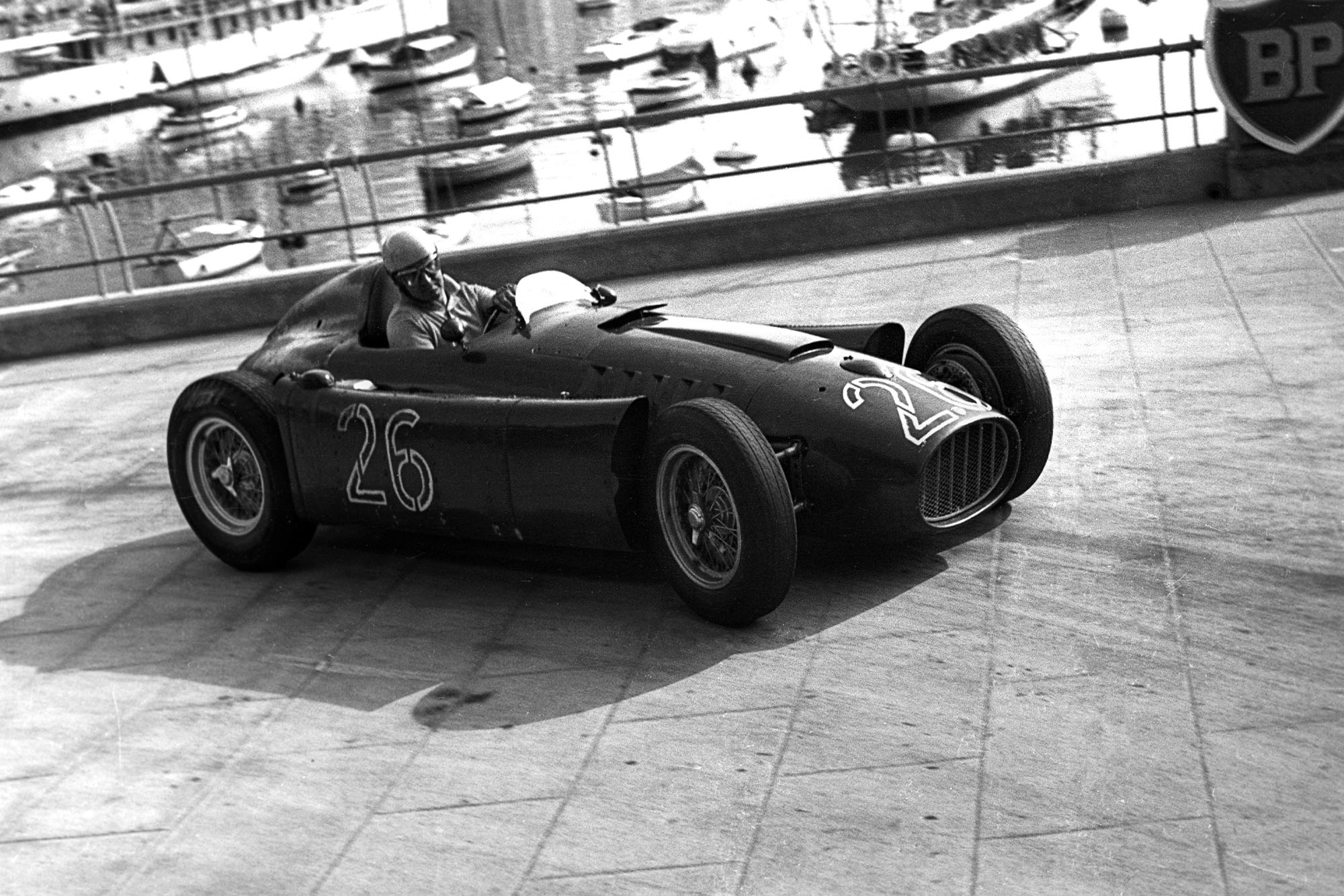 Alberto Ascari, Lancia D50, Grand Prix of Monaco, Circuit de Monaco, 22 May 1955. Alberto Ascari at the wheel of the Lancia D50 in the 1955 Monaco Grand Prix where, while in the lead, he crashed through the barriers into the harbour and had to swim to safety. Four days later, he was killed while testing in Monza.