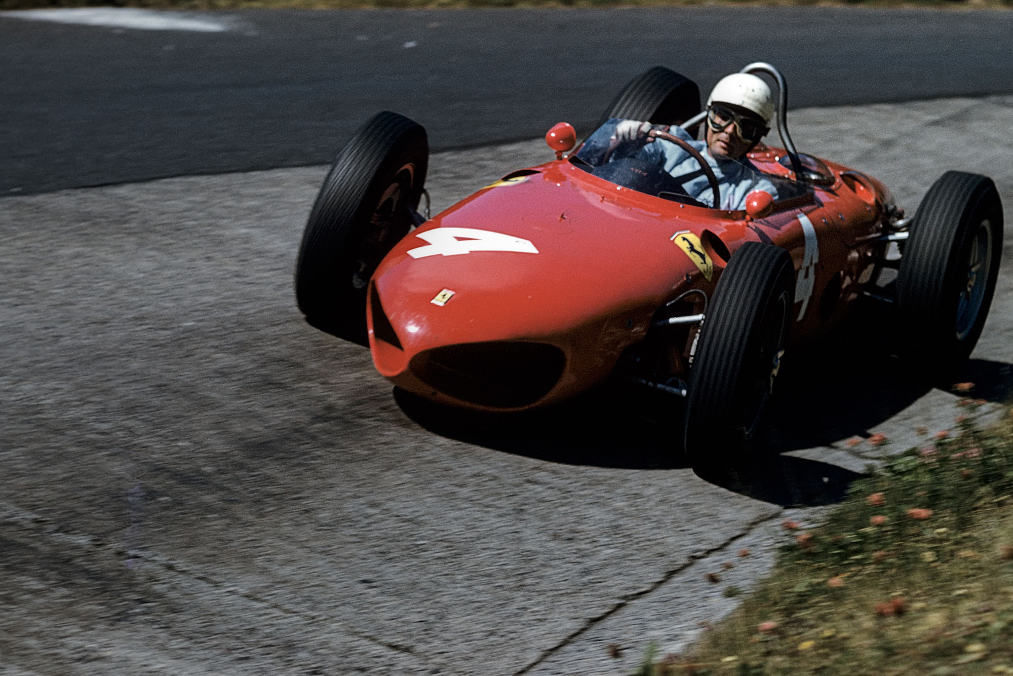Phil Hill, Ferrari 156 Sharknose, Grand Prix of Germany, Nurburgring, 06 August 1961. Phil Hill driving his Ferrari 156 on the famous Karussell corner at the Nürburgring. (Photo by Bernard Cahier/Getty Images)
