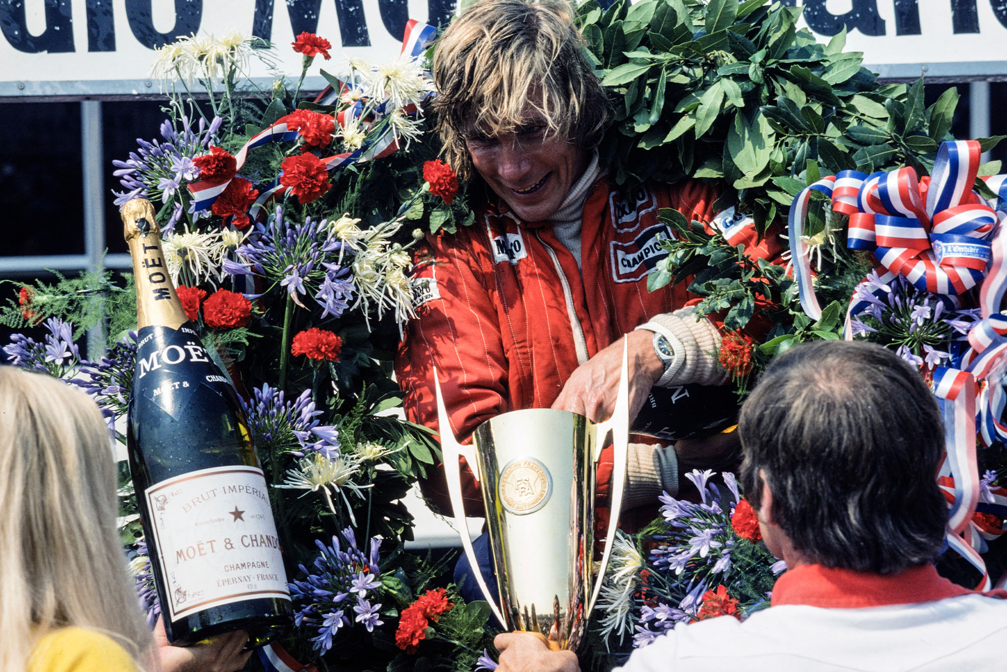 James Hunt (McLaren) celebrates his victory at the 1976 French Grand Prix, Paul Ricard.