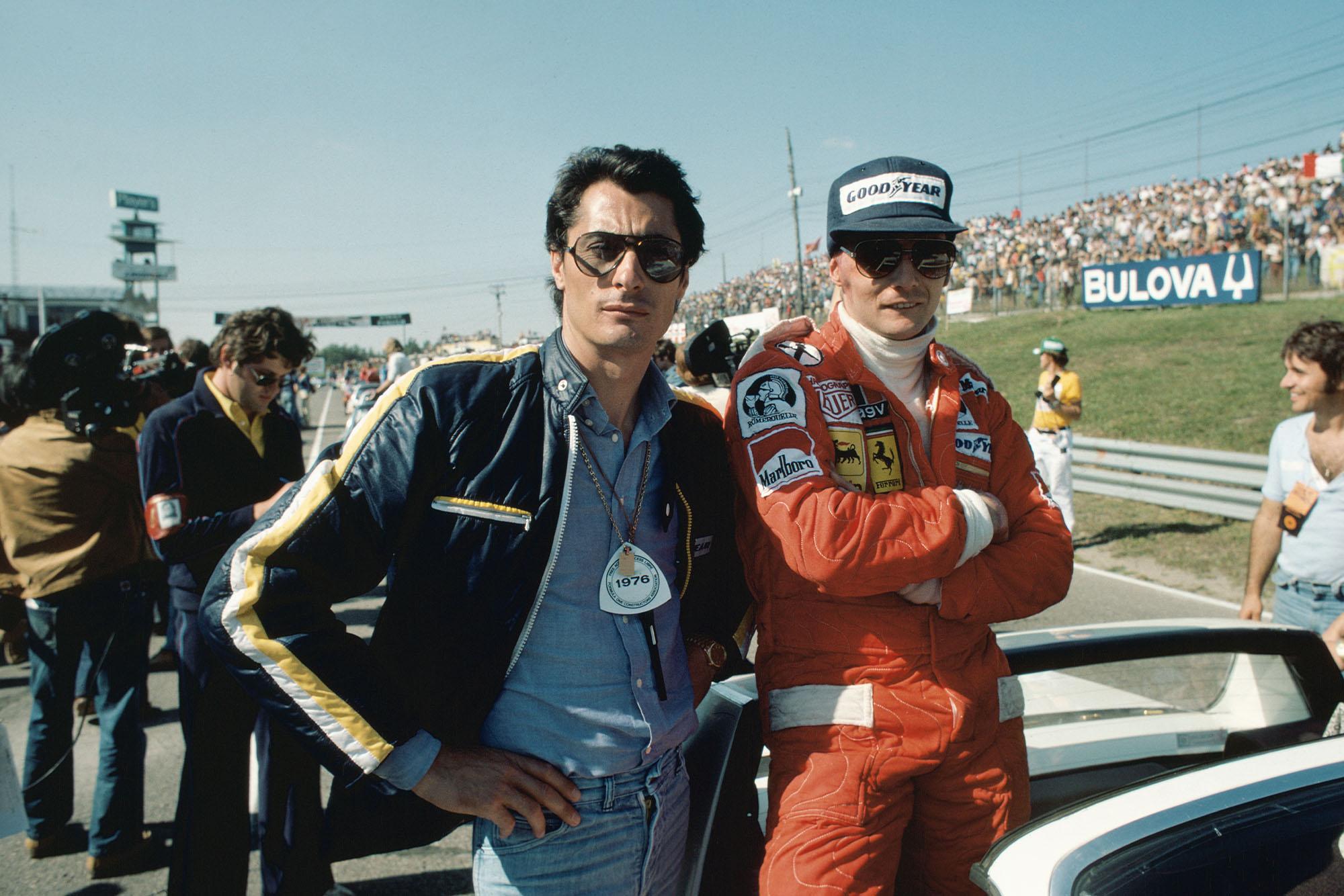 Niki Lauda (Ferrari) stands next to Scuderia team boss Daniele Audetto.