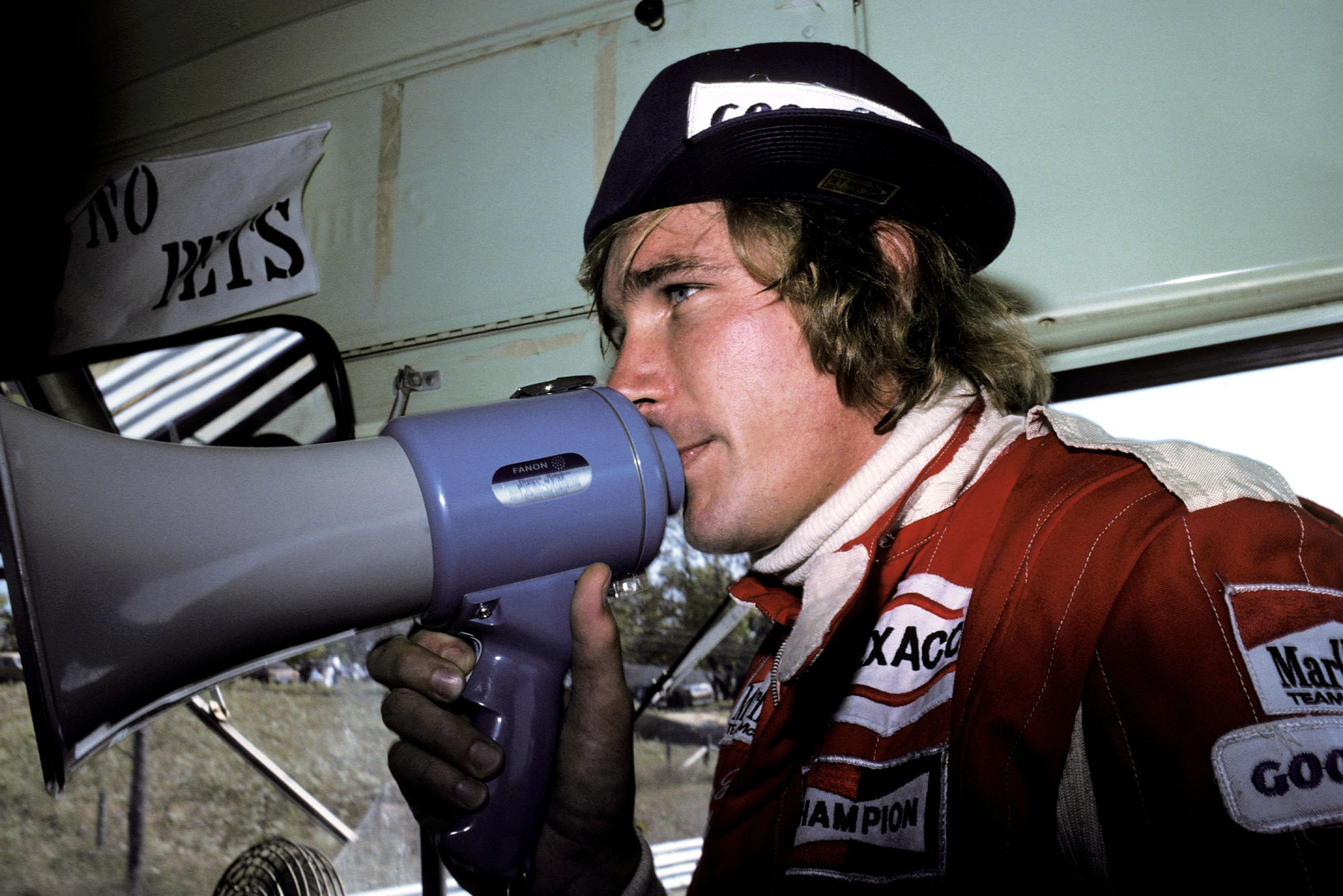 James Hunt (McLaren) helps give a track tour to race goers at the 1976 Canadian Grand Prix, Mosport Park.