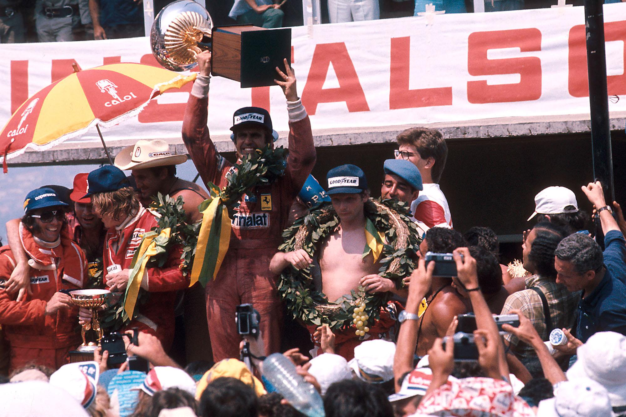 Carlos Reutemann celebrates his win at the 1977 Brazilian Grand Prix, Interlagos.